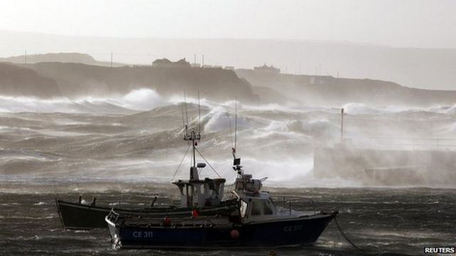 Boats shelter in Portrush harbour on the the north coast of County Antrim as storm force winds batter the north coast of Northern Ireland with gales forecast to reach 80mph. December 2011.