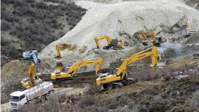 Diggers at landslide site