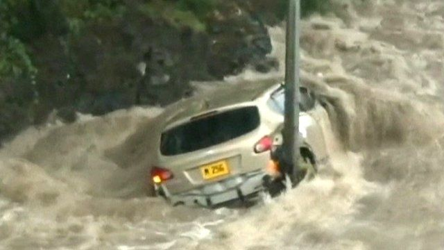 Vehicle surrounded by flood water