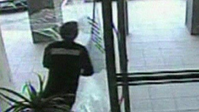 Man collides with glass door