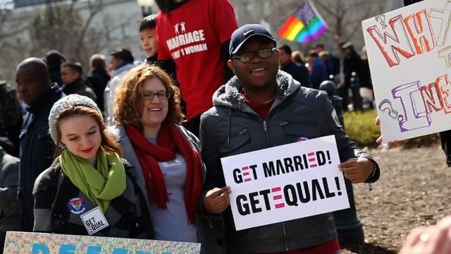 Supporters of same-sex marriage rally outside the Supreme Court building in Washington DC