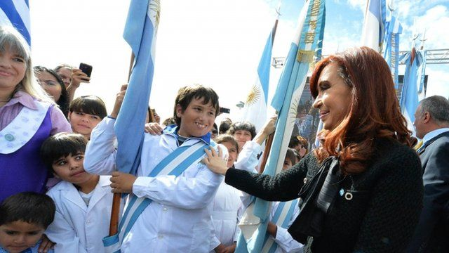Argentine President Cristina Fernandez de Kirchner (R) greeting pupils and teachers during the commemoration ceremony of the 31st anniversary of the 1982 Falklands War with Britain