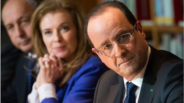 """French President Francois Hollande (R) attends a meeting with local civil society members at the Kingdom of Morocco""""s National Library in Rabat"""