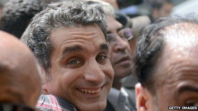 Egyptian satirist and television host Bassem Youssef is surrounded by his supporters upon his arrival at the public prosecutor's office in the high court in Cairo