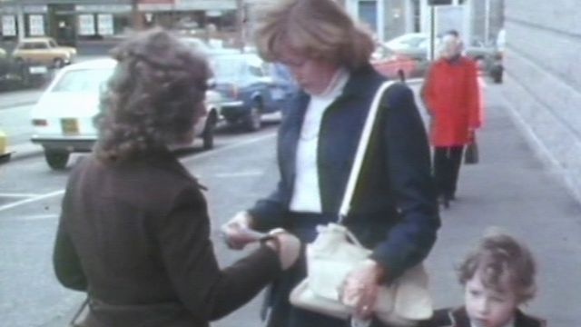 Woman handing out leaflets
