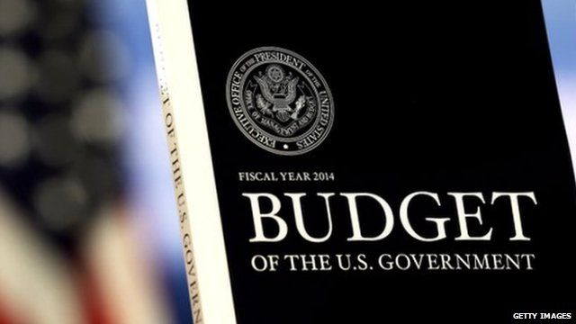 Copy of Obama's 2014 budget proposal and US flag