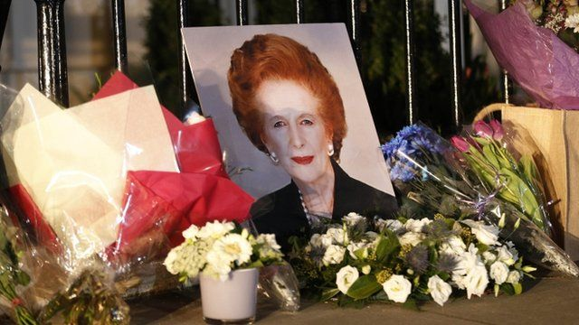 Flowers and a picture left outside the home of Margaret Thatcher