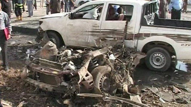 Damaged vehicles in the aftermath of one of the blasts