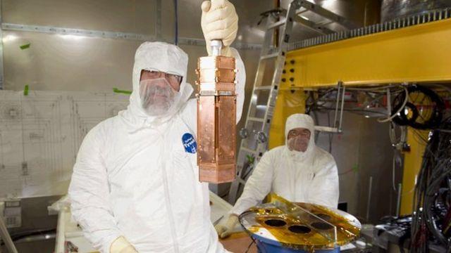 Dark matter experiment CDMS sees three tentative clues