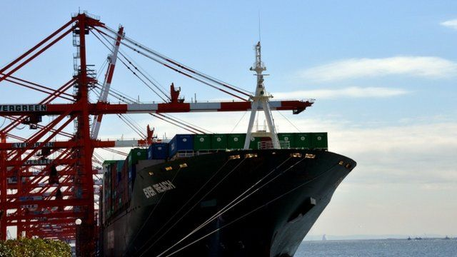 A cargo boat being loaded at the port of Tokyo