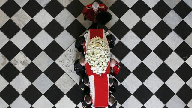 The coffin of Baroness Thatcher is carried out of St Paul's Cathedral