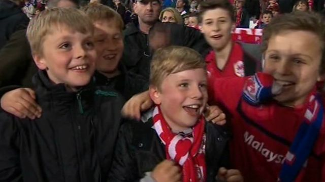 Young fans celebrate Cardiff City's promotion