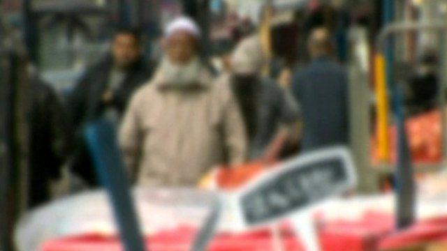 People walking in a Luton street