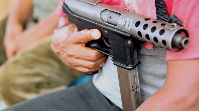 A gun held by a member of Ayulta's self-defence force