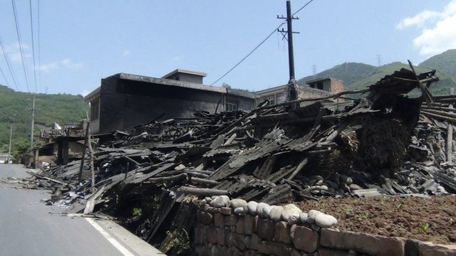 Collapsed houses are seen after an earthquake of 6.6 magnitude