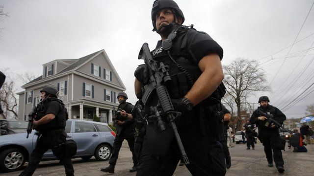 Police officers search house to house for Dzhokhar Tsarnaev