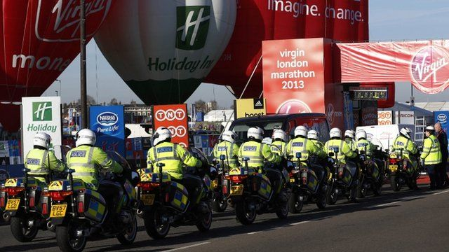 British police officers gather at the start at Blackheath during the London Marathon in London