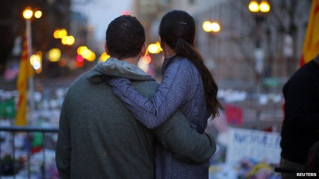 Couple embrace at memorial in Boston