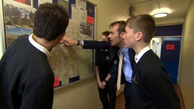 Teenage boys lost on Dartmoor look at map at school