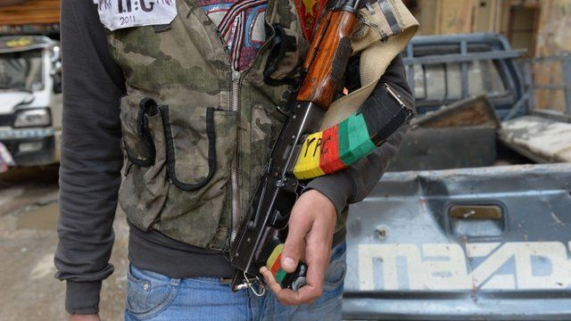 """A Kurdish fighter from the """"Popular Protection Units"""""""