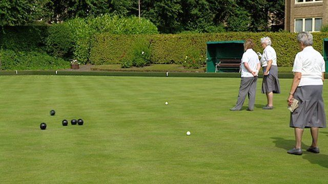 People playing bowls