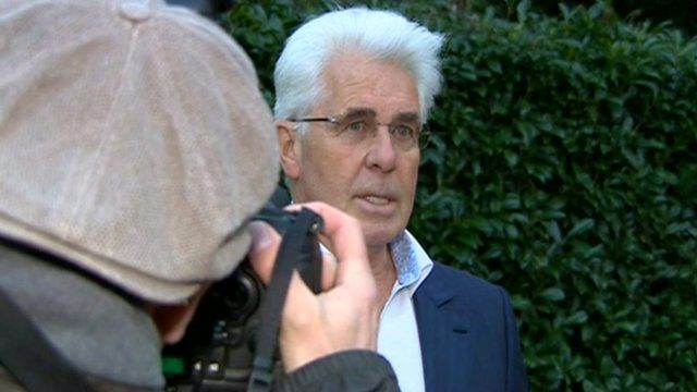 Photographer takes phone of Max Clifford