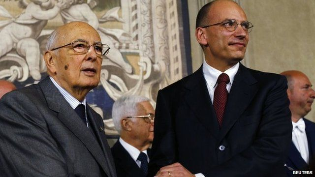 Italian Prime Minister-designate and deputy leader of the centre-left Democratic Party (PD) Enrico Letta (R) shakes hands with President Giorgio Napolitano