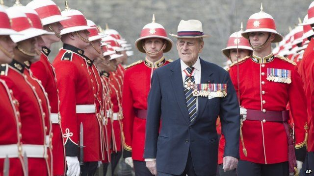 Prince Philip inspects an honour guard from the 3rd Battalion of The Royal Canadian Regiment in Canada