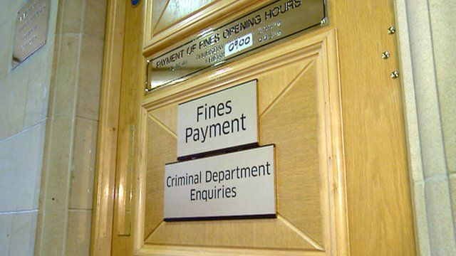 'Fines payment' sign