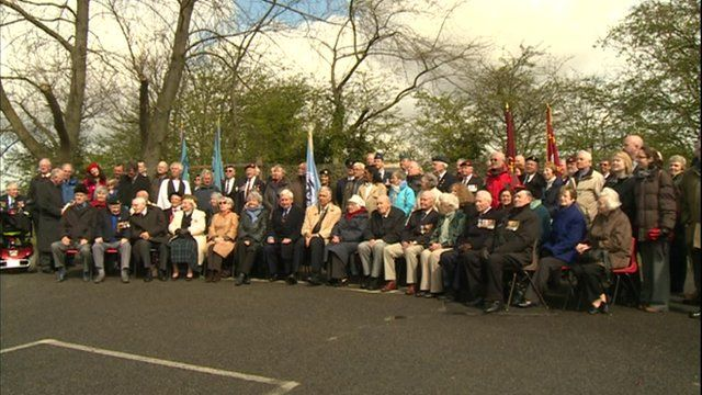 Former servicemen and resistance members gather for a ceremony at Eden Camp
