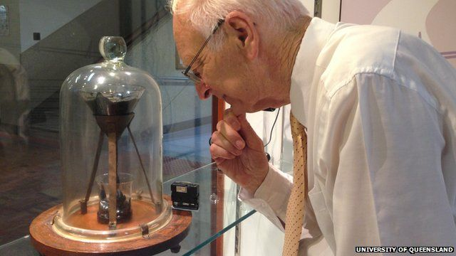 Prof Mainstone observing the pitch drop experiment at the University of Queensland