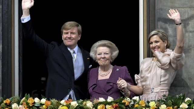 Princess Beatrix of Netherlands, her son, Dutch King Willem-Alexander and his wife Queen Maxima waving to crowds from a balcony