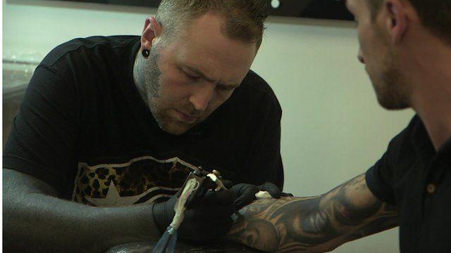 Tattoo artist Kevin Paul at work