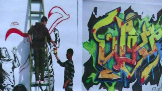 Graffiti being sprayed on a wall as part of the workshop