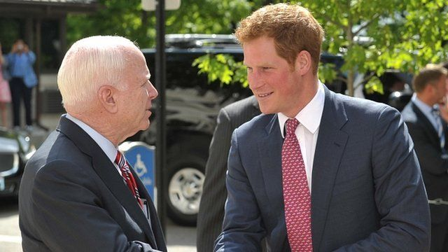 Senator John McCain (left) greets Prince Harry