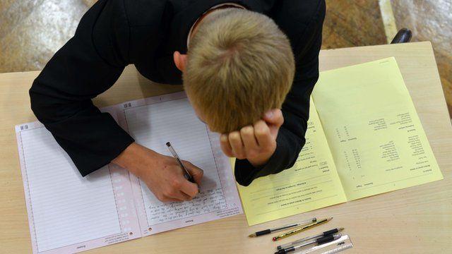 Boy taking an exam.
