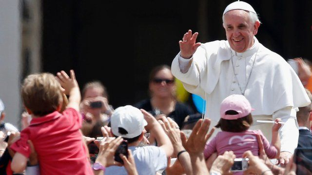 Pope Francis waves at child