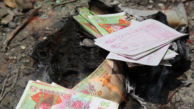 Paper money is burnt