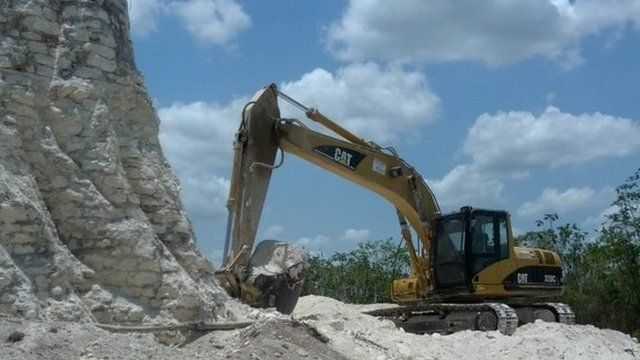 A photograph released on 13 May 2013 by archaeologist Jaime Awe shows a bulldozer at work at the Noh Mul site