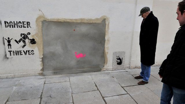 A section of wall where a Banksy mural was removed from