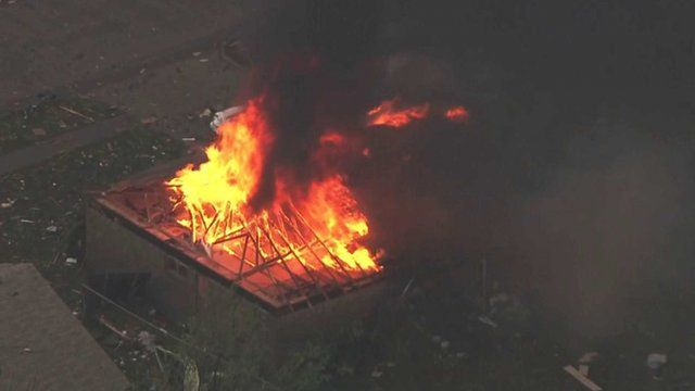 This photo provided by KFOR-TV shows a house fire outside Moore, Okla