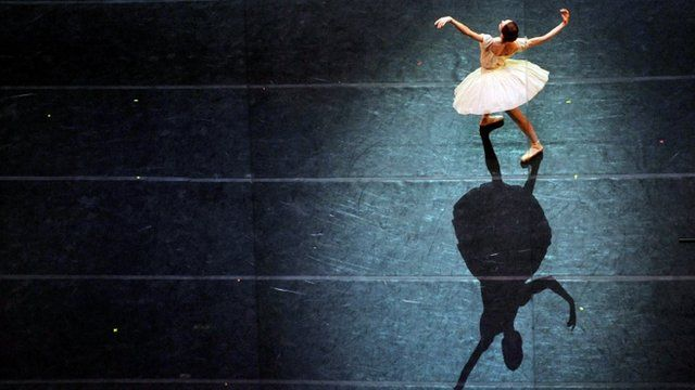 A ballerina performs during a dress rehearsal