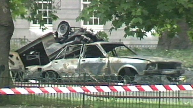 A burnt out car from the aftermath of a bomb in Hyde Park in 1982