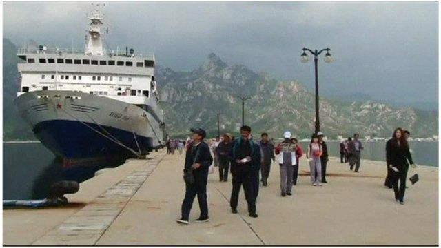 Chinese tourists arrive in North Korean resort.