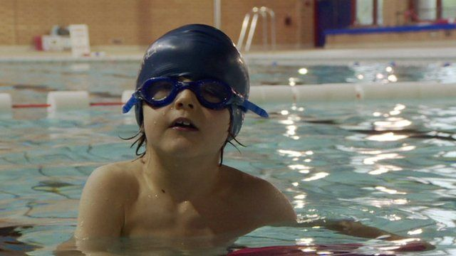 A child in a swimming pool