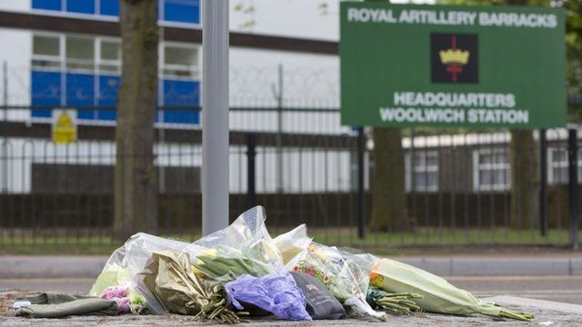 Floral tributes are seen outside the Royal Military Barracks
