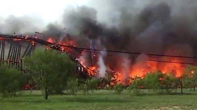 Railroad bridge burns down