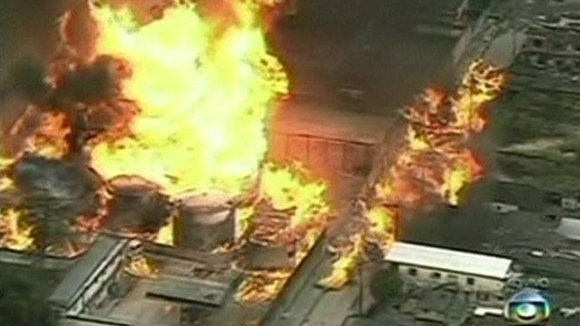 Flames leaping from Rio fuel depot