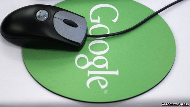 A mouse and Google mousepad