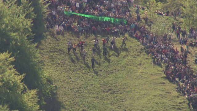A cheese-rolling race begins in Gloucestershire